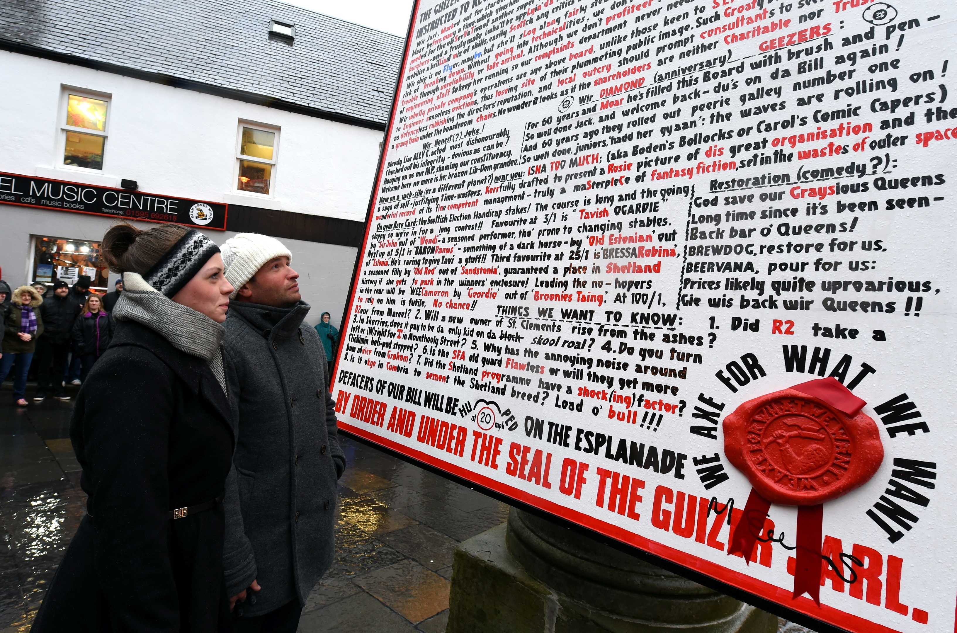 Up Helly Aa, Lerwick, Shetland. Looking at the Guizer Jarl's message on Commercial Street,
