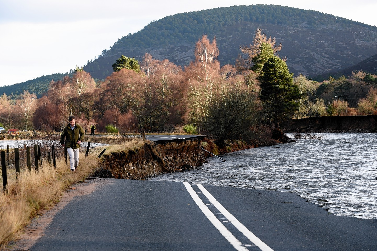Part of the A93 washed away due to flooding between Bridge of Gairn and Crathie. Picture by Kevin Emslie