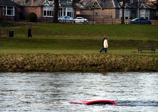 Police dive units could be used to help remove a car from the River Dee
