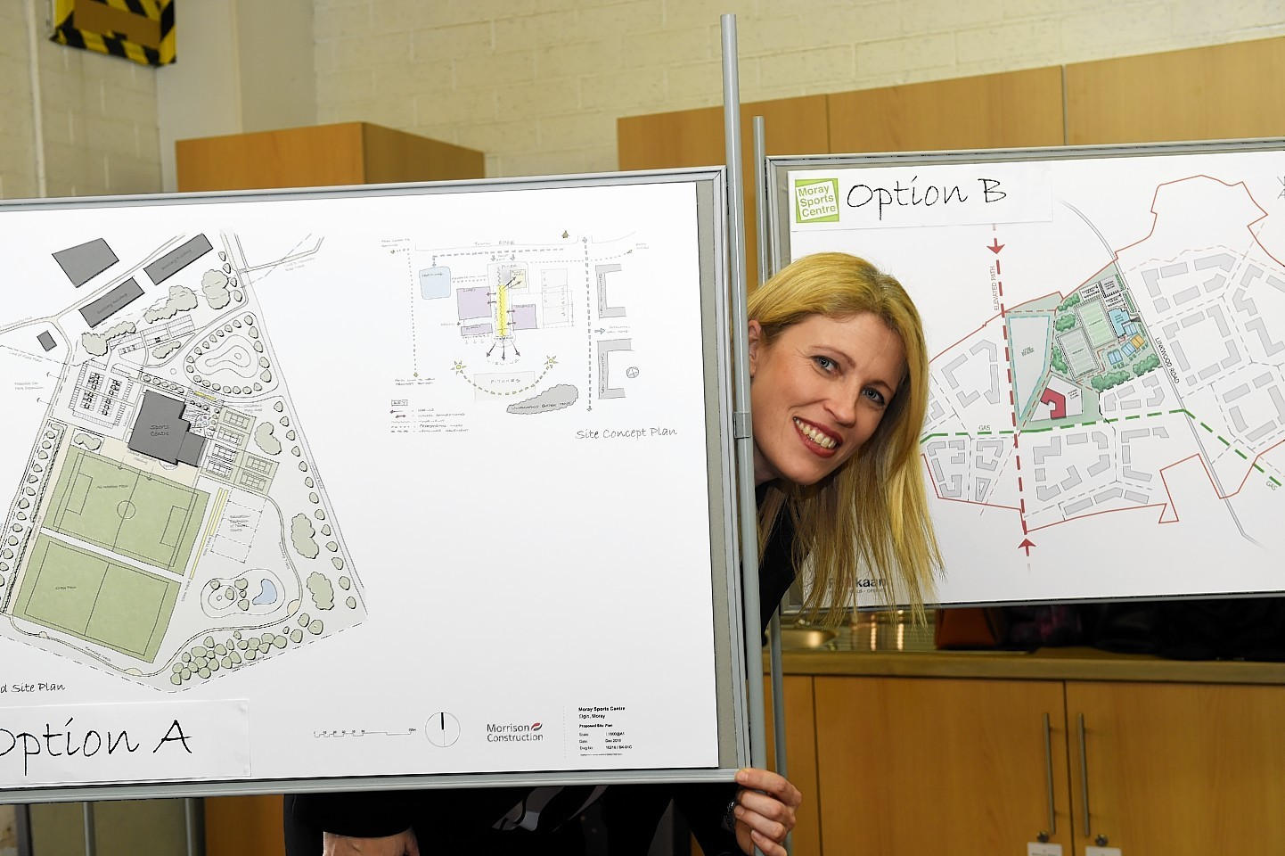 Kathryn Evans, Project Leader of Moray Sports Centre, with optional plans for the new sports centre. Picture by Gordon Lennox