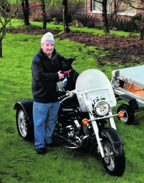 Brian Gray from Balmedie with his three trikes - and dog Timmy. Pictures by Colin Rennie