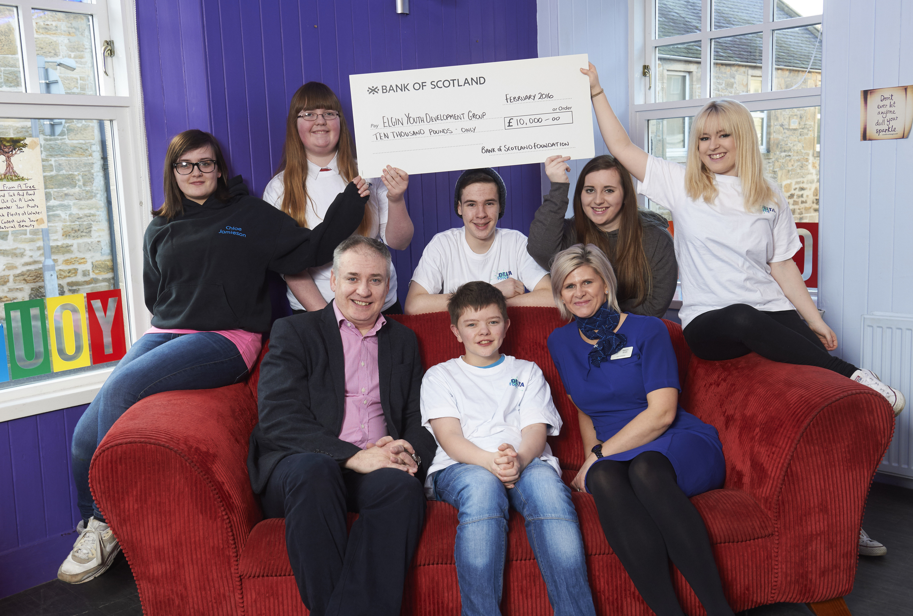 Elgin Youth Cafe Cheque Presentation, Names LtoR 1&2 (Back row) Chloe Jamieson, Emily Burns, Liam Hughes, Sarah Fiske (Youth Worker) and Adele Starr.         (Front row) Richard Lochead MSP, Aiden Henderson and Naomi Smith (Bank of Scotland)