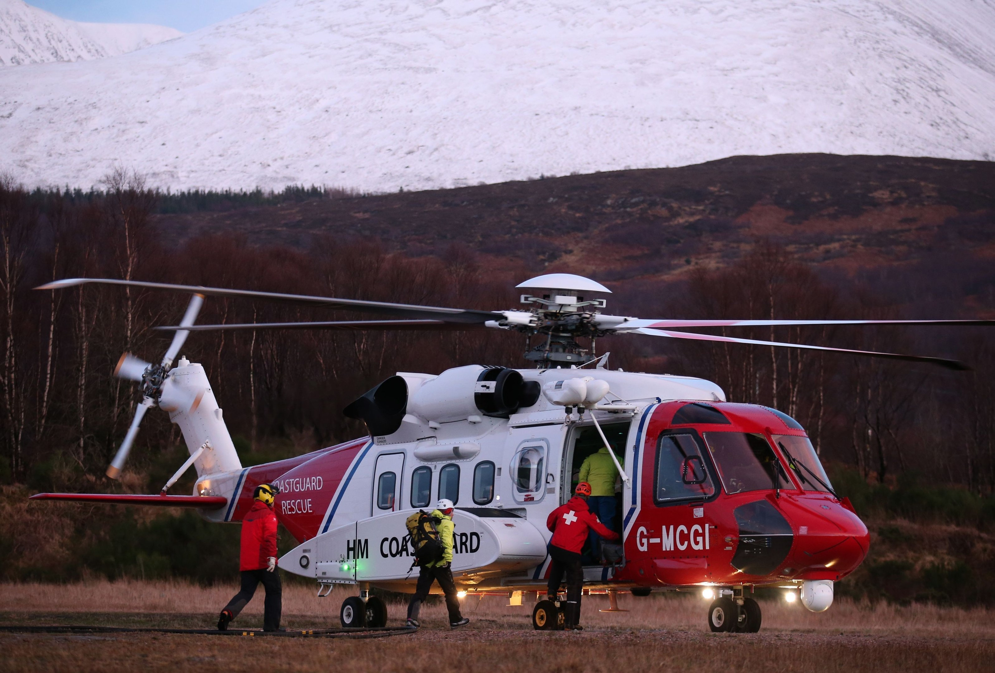Members of the Lochaber Mountain Rescue team board a search and rescue helicopter after an avalanche in the. PRESS ASSOCIATION Photo. Picture date: Wednesday February 17, 2016. See PA story POLICE Avalanche. Photo credit should read: Andrew Milligan/PA Wire