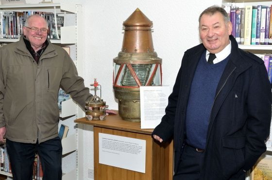 Community councillors George Ritchie (left) and David Buchan (right) with the Cairnbulg  beacon.