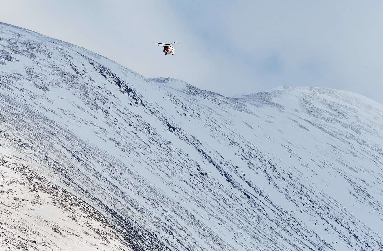 The helicopter was searching Ben Nevis for missing climbers when it was called away