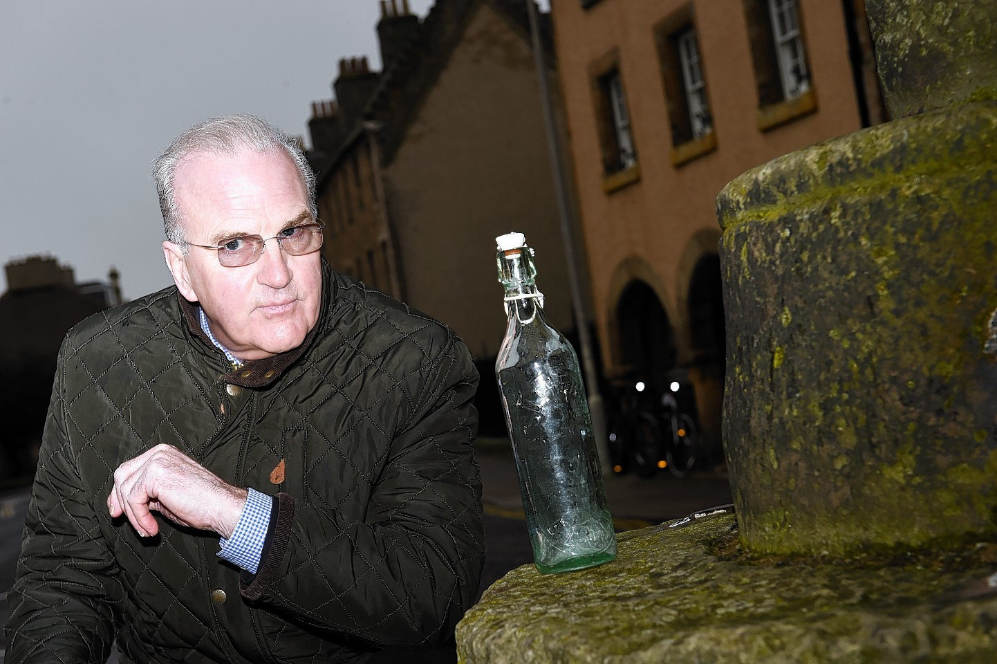 Jim Royan contemplates on an old Elgin bottle