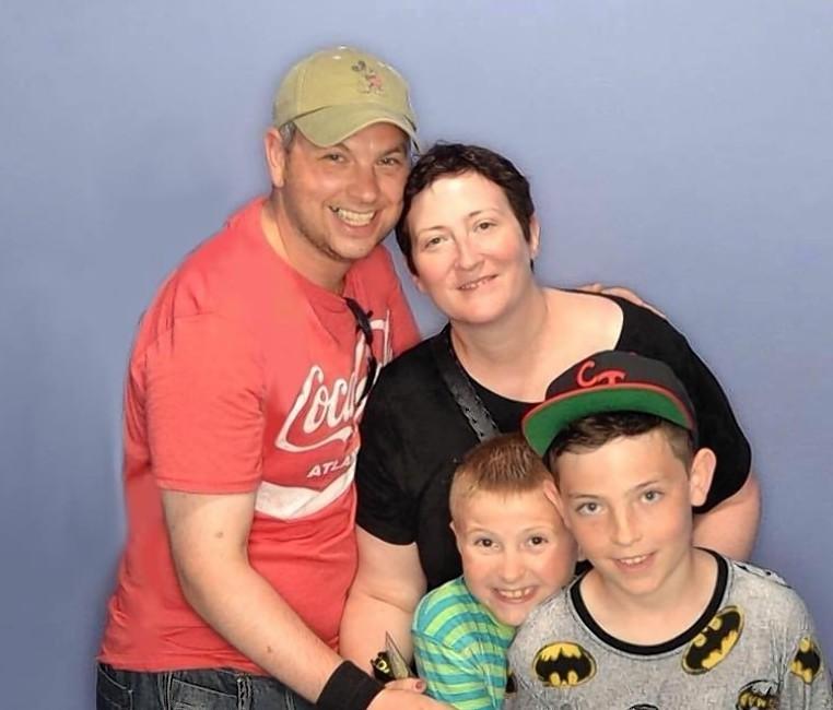 Caroline Thomson with husband David and sons Callum and Robbie