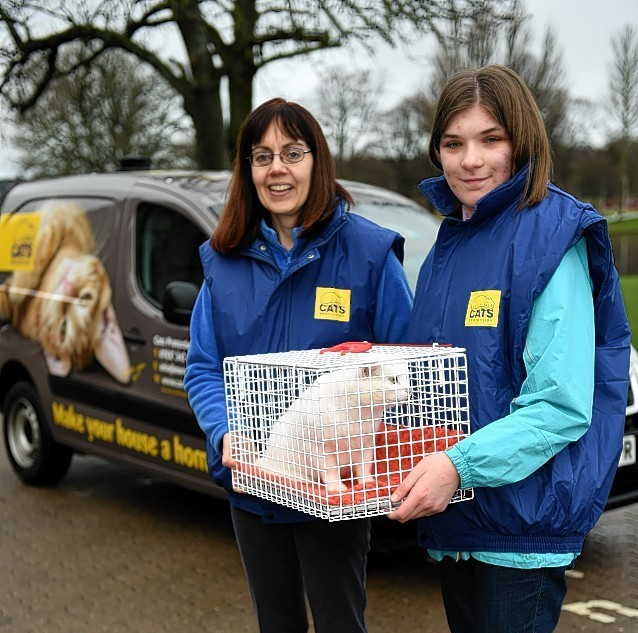 Jane Lax, left, coordinator Cats protection Moray, with Vinnie the cat, and Rachel Watson, volunteer