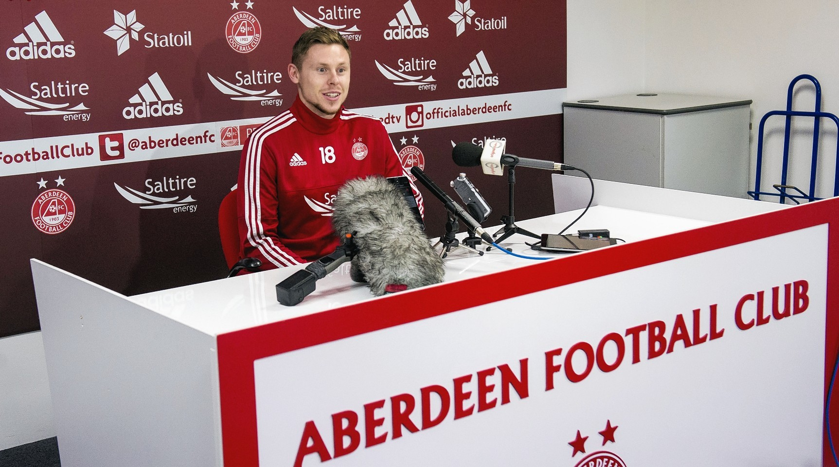 Simon Church speaks to the media after completing his move to the Dons