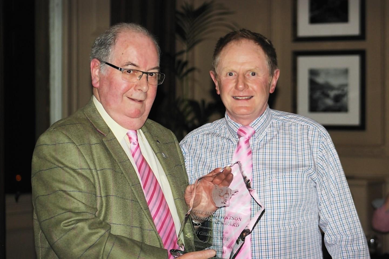 Eddie Gillanders receiving his award from David Evans