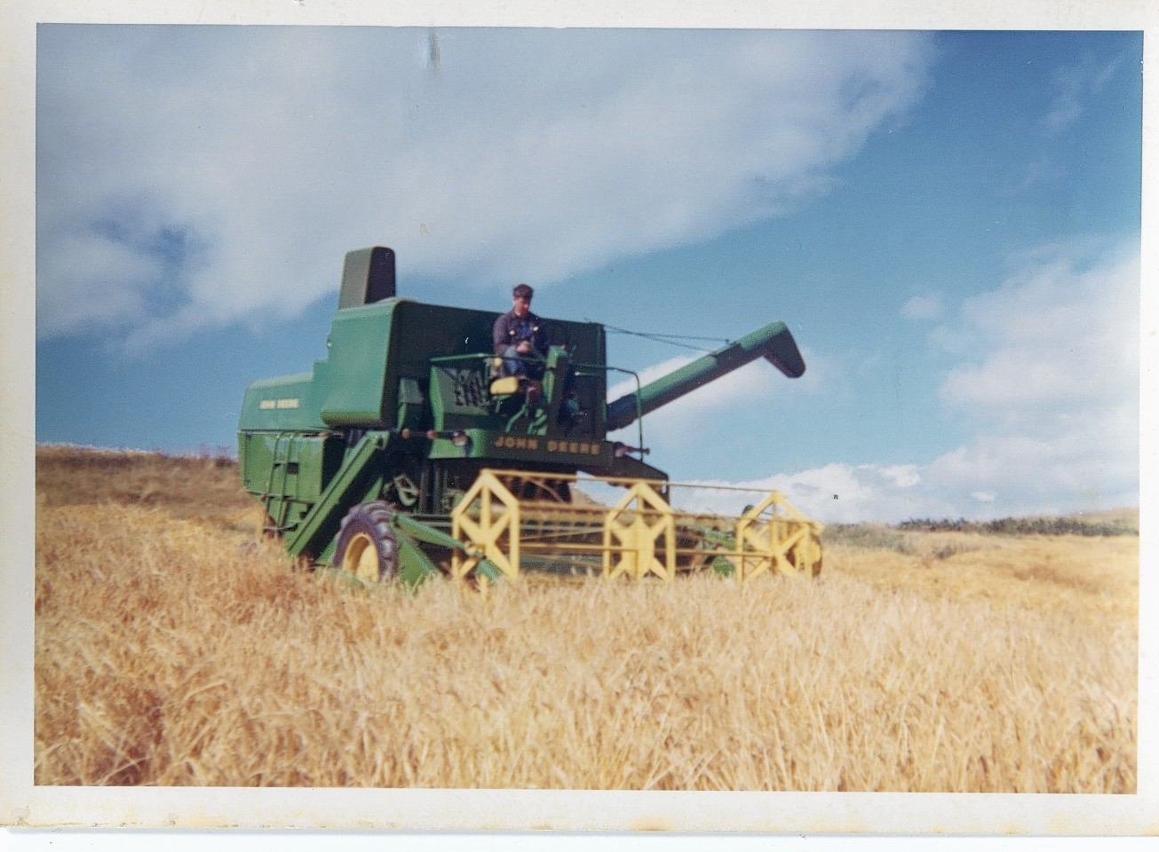 A John Deere 530 combine at work in the 1960s