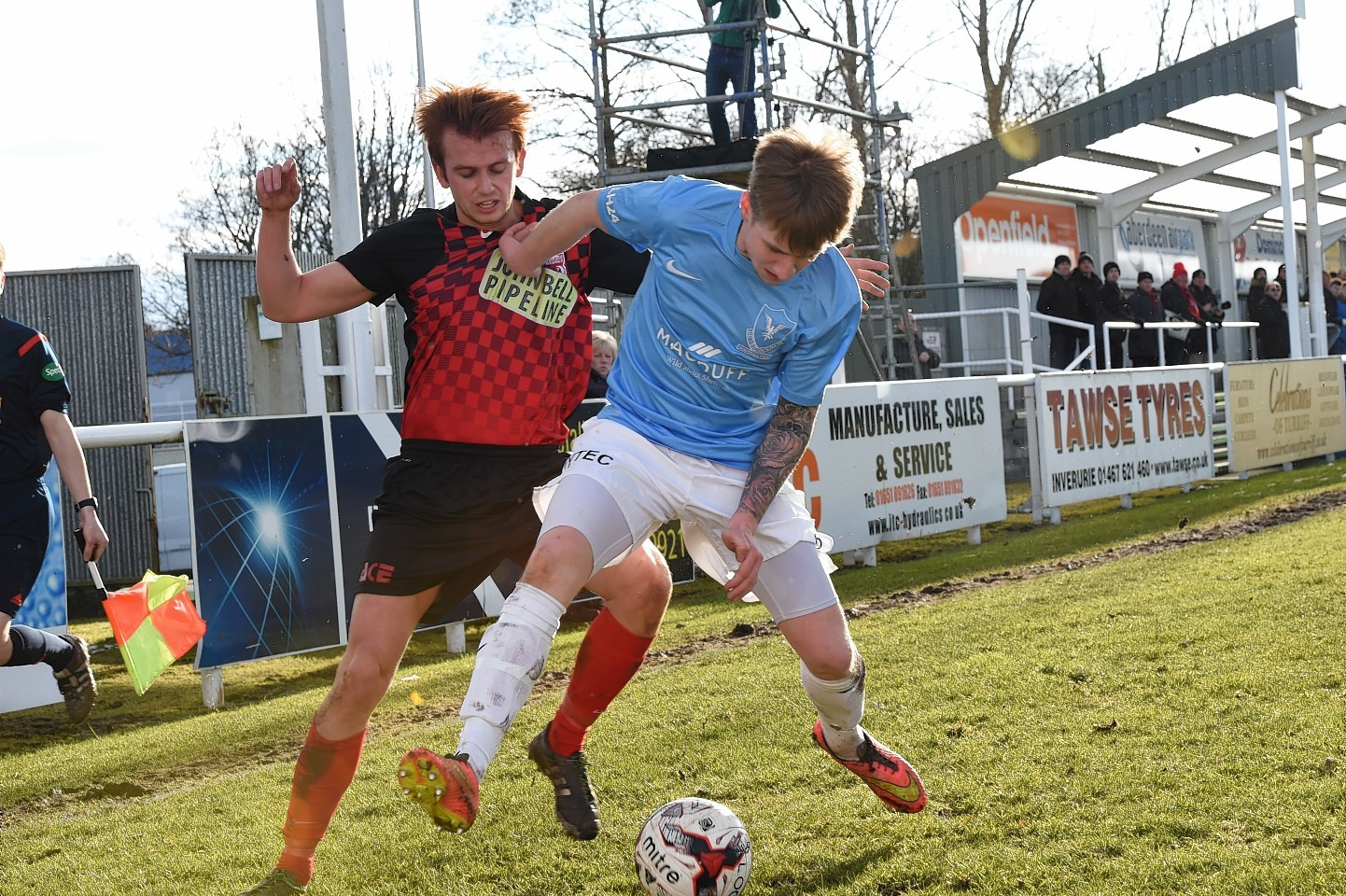 Inverurie Loco's Martin Laing challenges Deveronvale's Craig Simpson in the first half at Harlaw Park this afternoon.