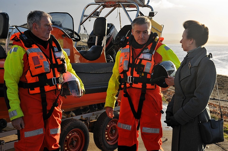 The Princess Royal speaking to Donald Watson, left and Ian Cassells, right, both members of Moray Inshore Rescue Organisation at Findhorn