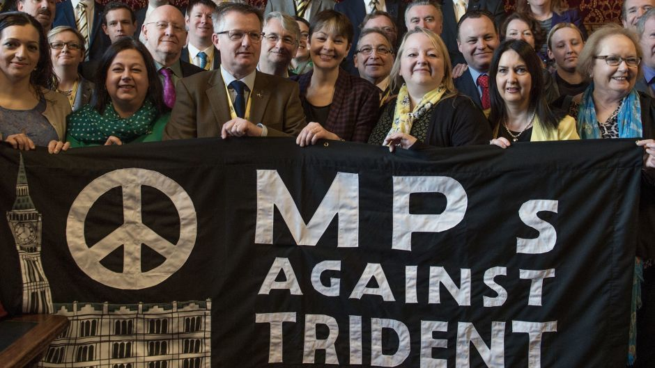 MPs hold a banner following a CND press conference to announce a Stop Trident demonstration in London