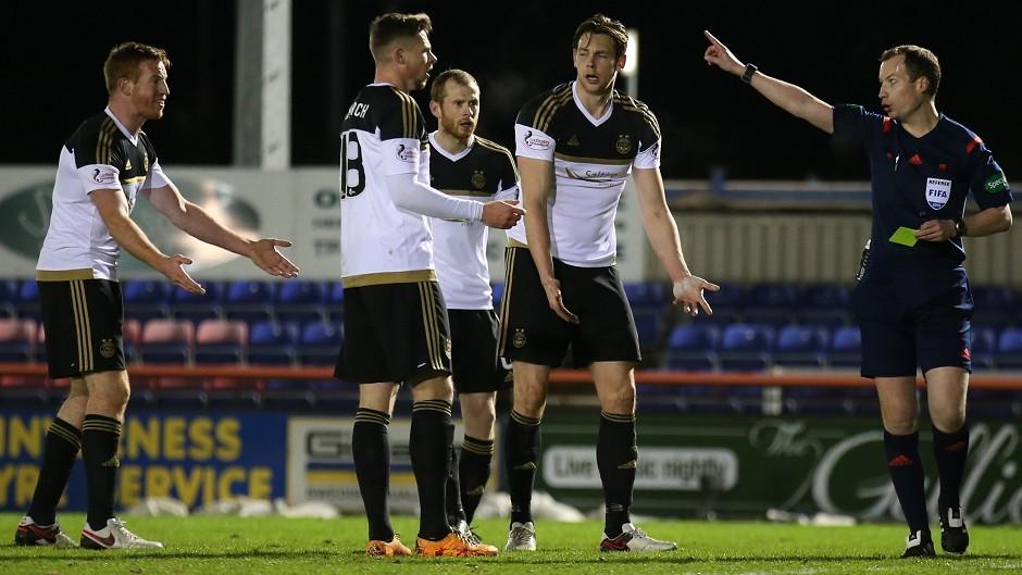 Aberdeen boss Derek McInnes was not happy with referee William Collum, right