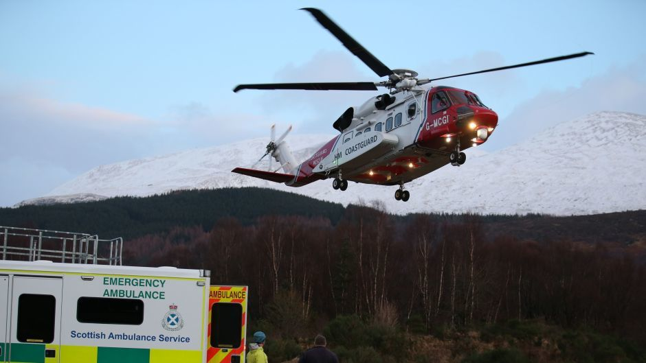A casualty arrives by a search and rescue helicopter after an avalanche in the Creag Meagaidh area