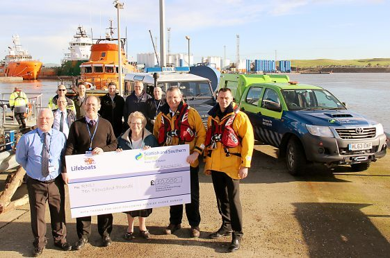 Shepd's team presenting a cheque for £10,000 at the RNLI's Aberdeen Lifeboat Station
