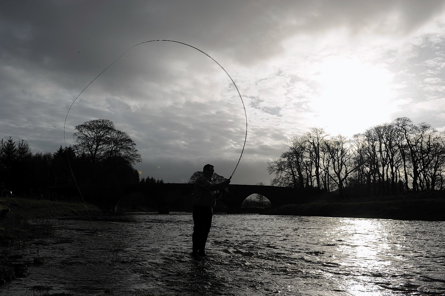 Craig Wyness throws the first line into the River Deveron.