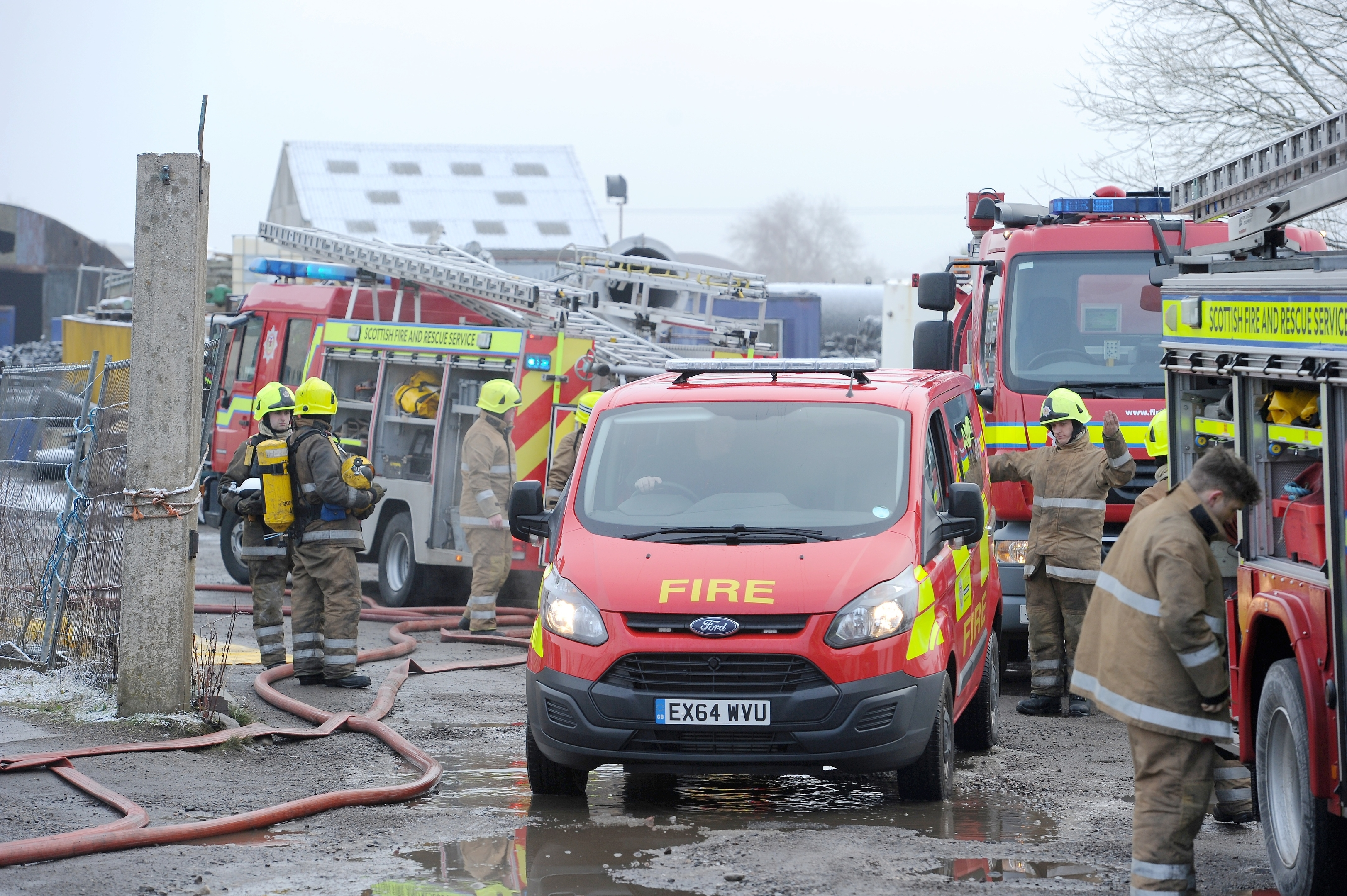 Firefighters deal with the fire which destroyed part of the Tarradale Game factory in Muir of Ord yesterday morning. (Friday)