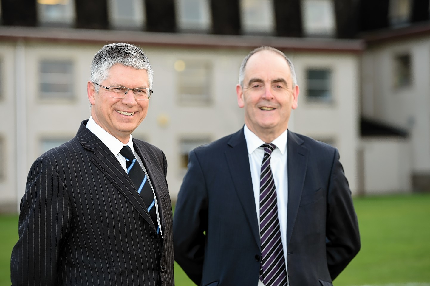 Elgin High School headteacher, Andy Simpson, left, and Moray Council head of lifelong learning, culture, and sport, Graham Jarvis