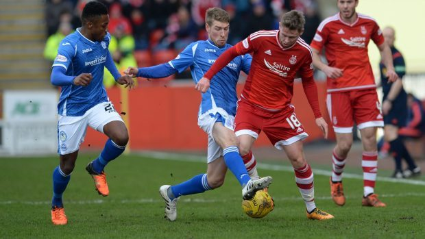 Aberdeen goalscorer Simon Church battles for possession
