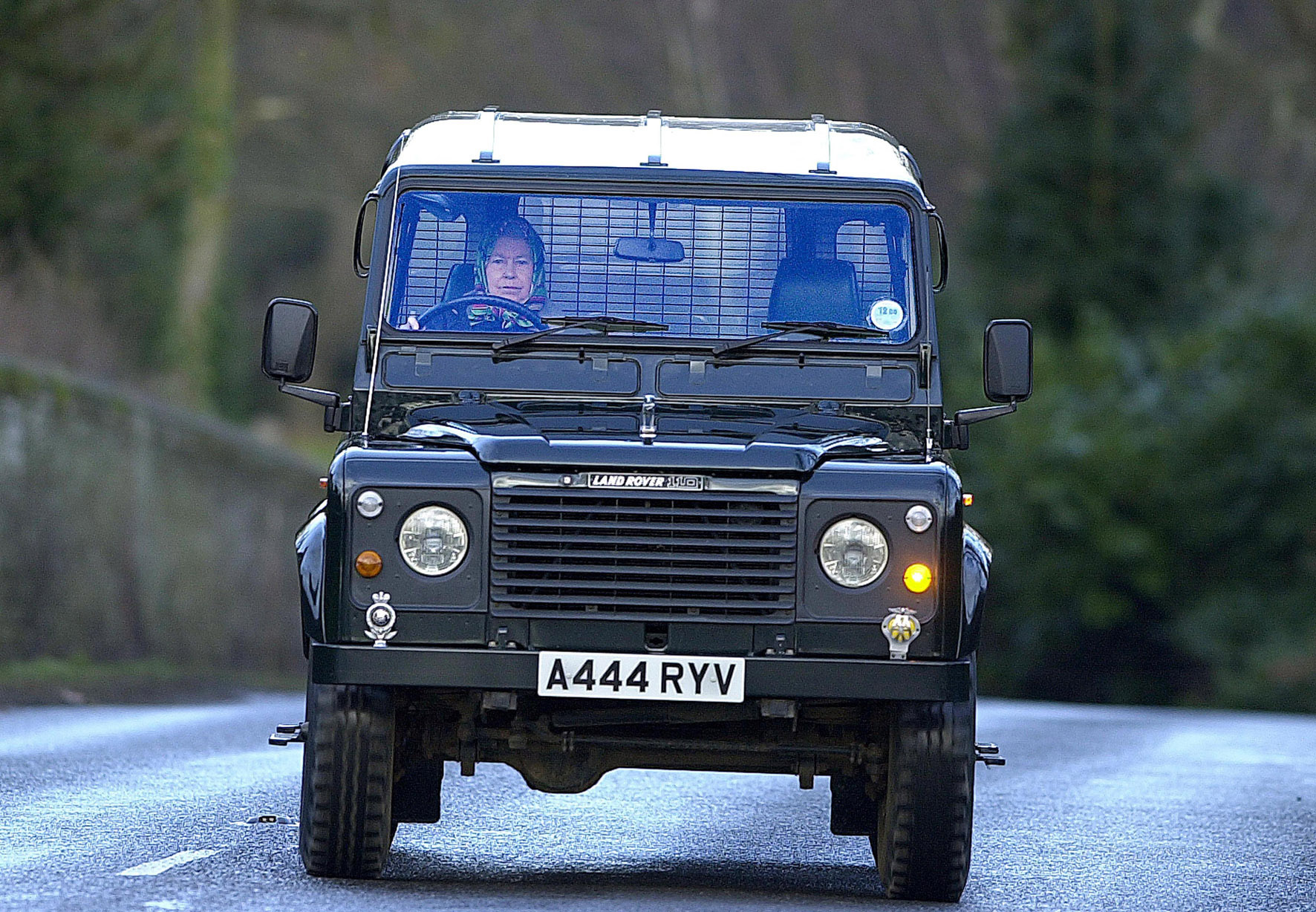 Queen Elizabeth II in a Land Rover Defender 110