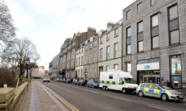 Police on the scene  following the death of a woman within a residential property on Union Terrace, Aberdeen.       Picture by Kami Thomson