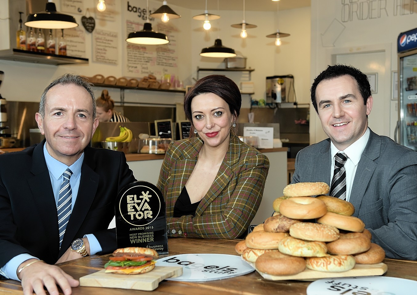 Pictured at the launch of the 2016 Elevator Awards - L-R Elevator Chief Executive Gary McEwan, Bagels & Stuff owner Louise Divarquez and RBS corporate and commercial banking director Russell Whyte