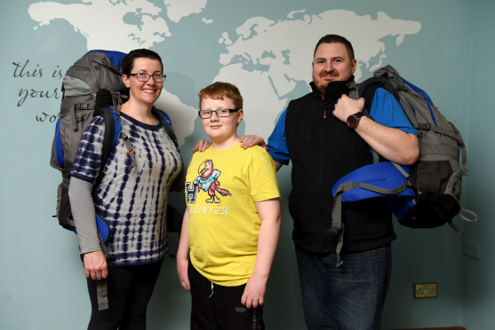 Lynne and Alex Mennie and son Connor, 12, are setting off on a once in a lifetime trip
