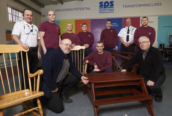 Group of prisoners pictured with Iain Wylie (left) and Eric Robb (SPS Officers) with Martin Robb (Front left) and David Parker (Front right) from Inverness College.