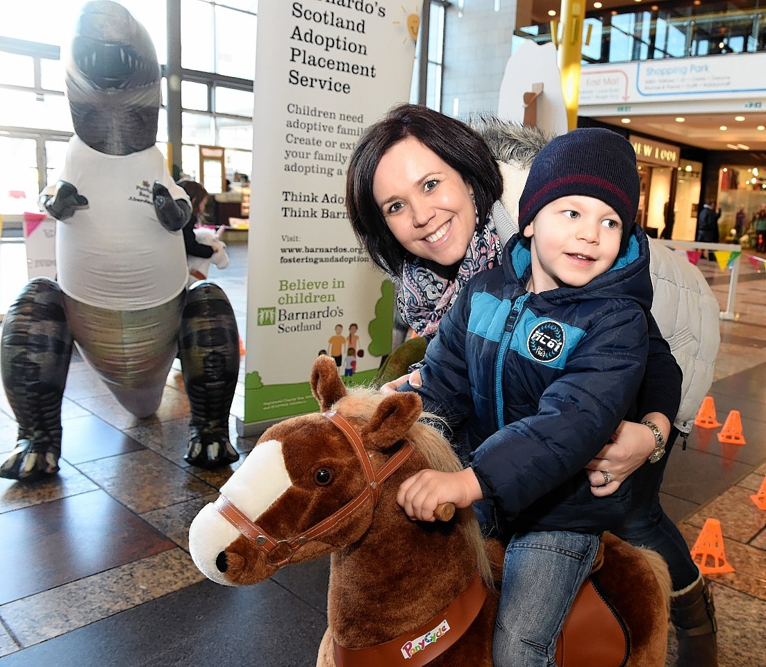Phillip Eloff, 3, with his mum, Carina, at the Barnardo's stand in Union Square, Aberdeen. Picturn by Jim I.rvine