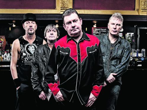 Jake Burns, front, with the rest of Stiff Little Fingers. PHOTO: Ashley Maile