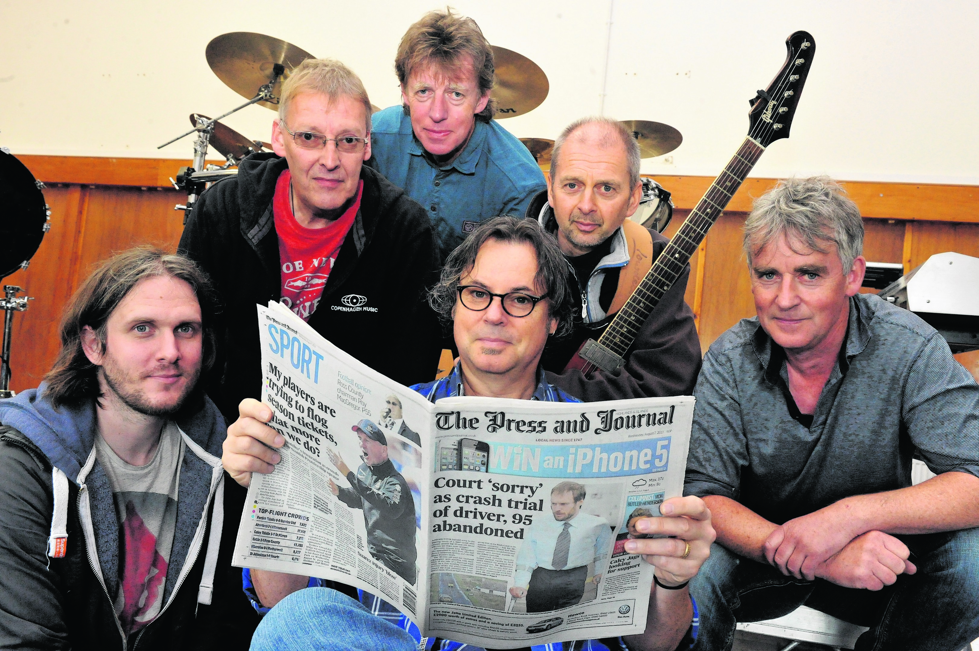 7Aug13.  Balloch, Inverness-shire.  Runrig chat to The Press & Journal before their 40th anniversary gig on the Black Isle.  Pictured from left, Brian Hurren, Iain Bayne, Rory Macdonald, Bruce Guthro (holding paper), Malcolm Jones and Calum Macdonald. . Picture by David Whittaker-Smith.          .07/08/13