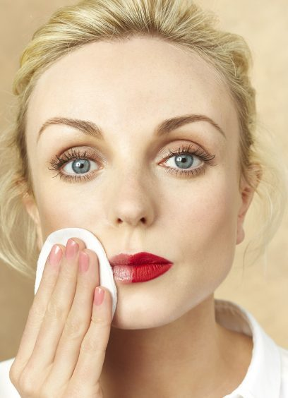 Helen George using a face wipe
