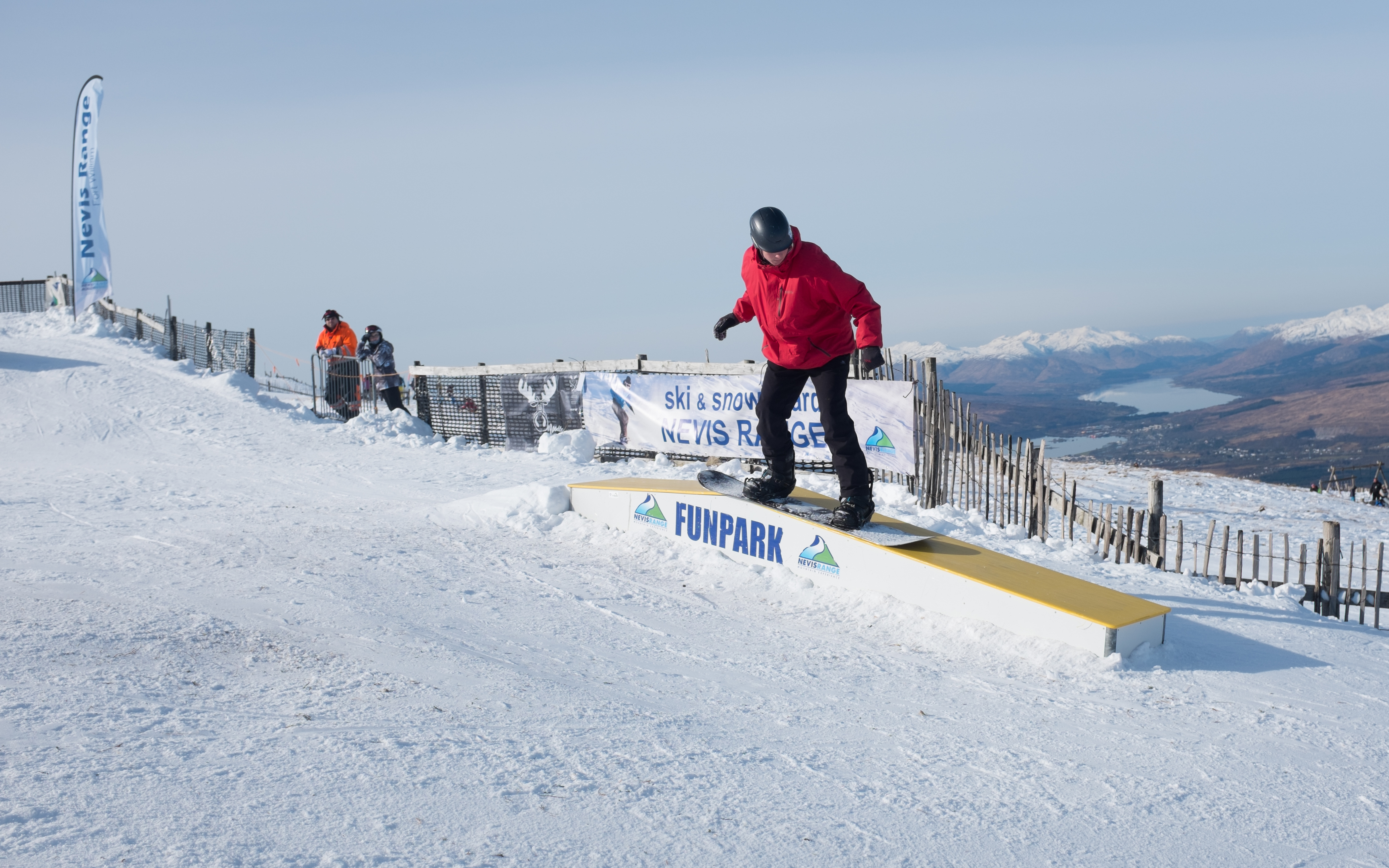 A snowboarder tries the new Rail Park at Nevis Range