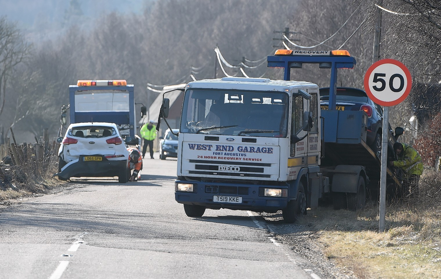 Vehicles are recovered from the scene of the crash on the A887