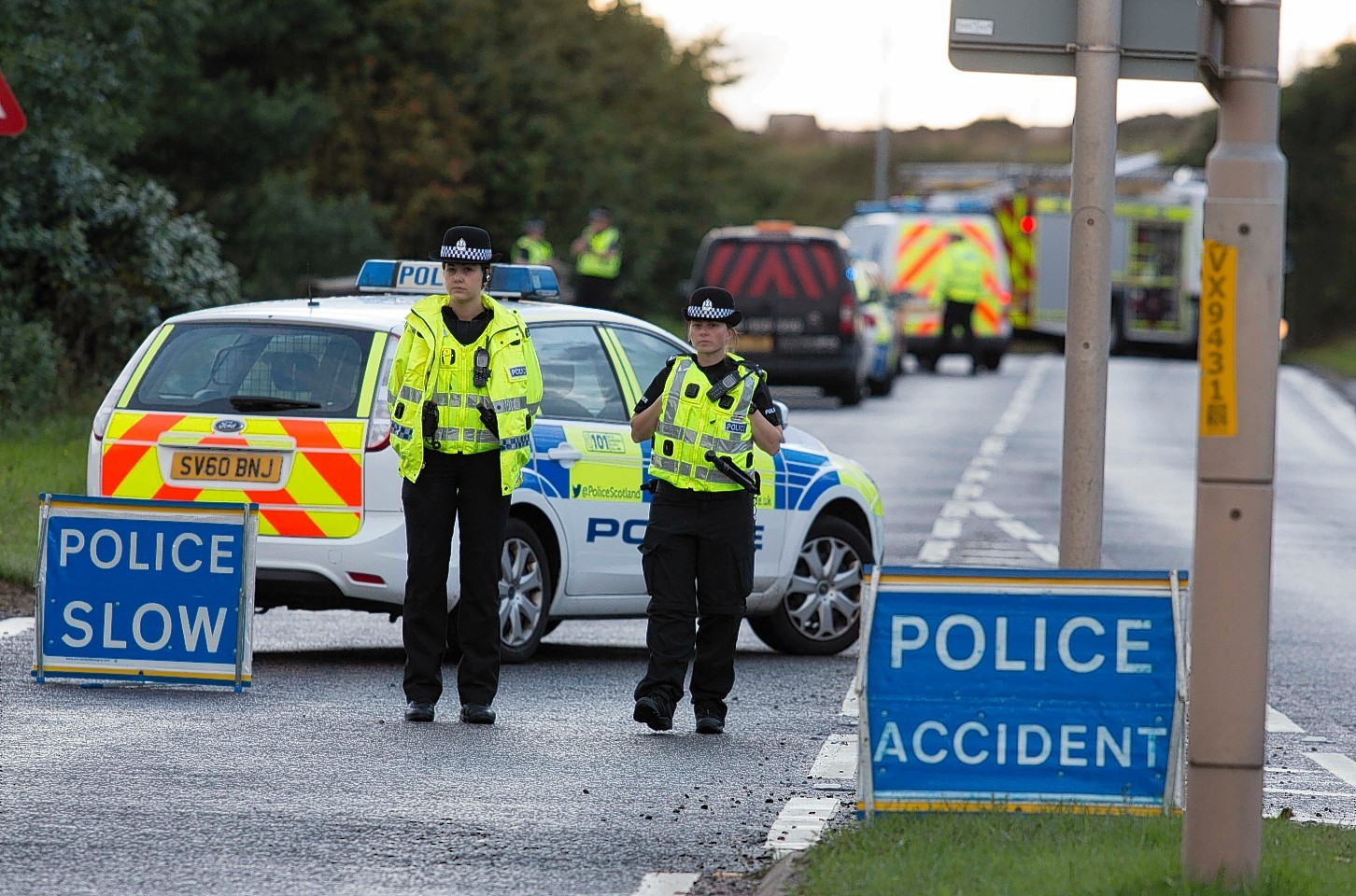 Police officers on the scene of the crash