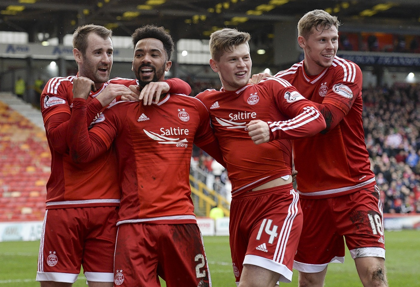 Shay Loganis congratulated by team mates Niall McGinn, Cammy Smith and Simon Church after scoring Aberdeen's second goal