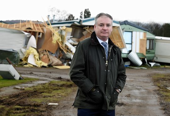 The environment secretary, Richard Lochhead on a visit to Ballater to check the flood damage, In the picture is Richard Lochhead at the caravan park, Ballater.  Picture by Jim Irvine  4-3-16