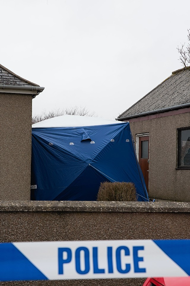 Police outside Brian McKandie's home at Fairview Cottages, Rothienorman