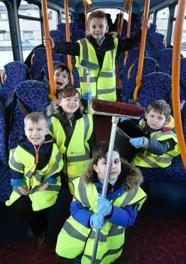 Charlie Thomson (front left) of North Kessock with some of his classmates from North Kessock Primary School as they clean a Stagecoach Bus in Inverness to raise funds to buy specialist equipment for Charlie.