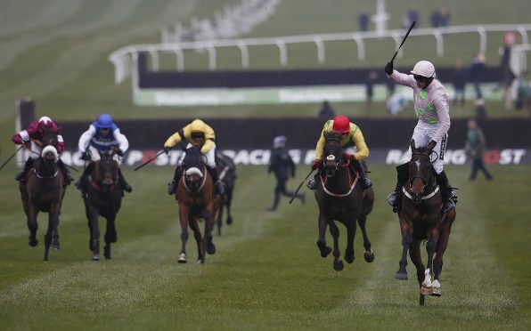 Ruby Walsh riding Douvan to victory in The Racing Post Arkle Challenge Trophy on day one at Cheltenham