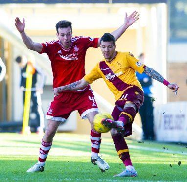 Motherwell's Marvin Johnson battles with Aberdeen's Andrew Considine