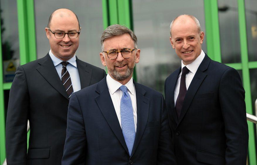 Stuart MacGregor (Group Finance Director), Lord Dunlop and John Slater (Group Managing Director, Stewart Milne Homes). Picture by Kenny Elrick