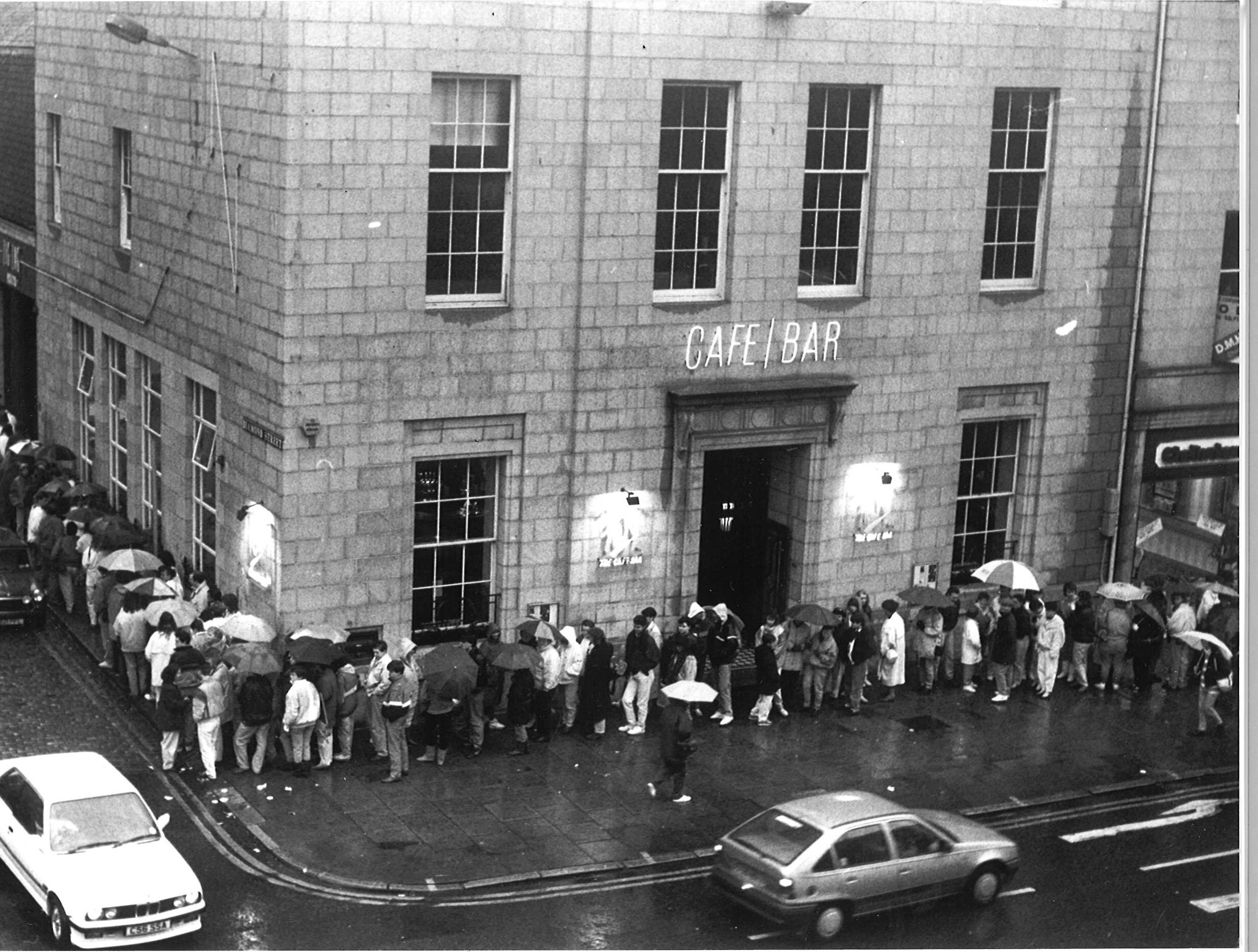 DEC 1989. Fans queue at One Up in Diamond Street at 5am to bag tickets