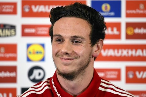 Danny Ward is all smiles as he speaks to the press