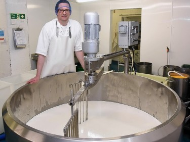 Rory Stone in the cheese factory