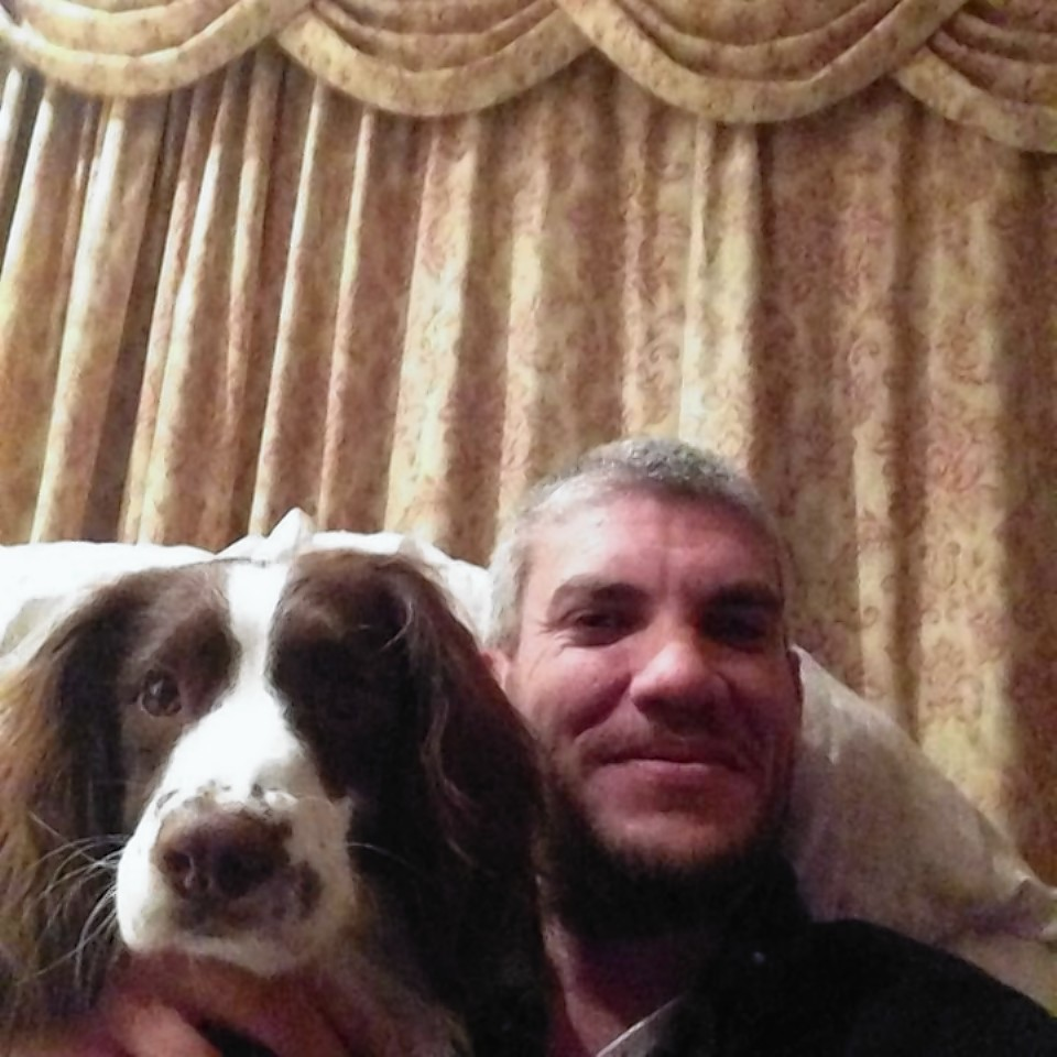 Jason Gates and his beloved pet dog