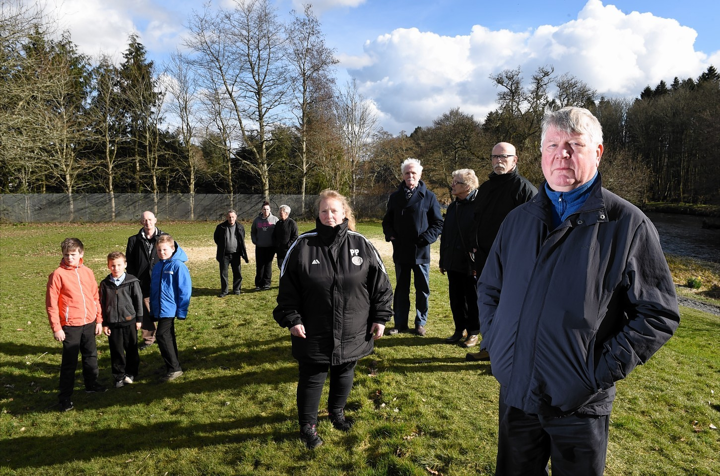 Kemnay residents with Ken Leddingham (right) at the gap in the bund at Kembill Park which they want the council to fix after water flooded the houses there.  Picture by KEVIN EMSLIE