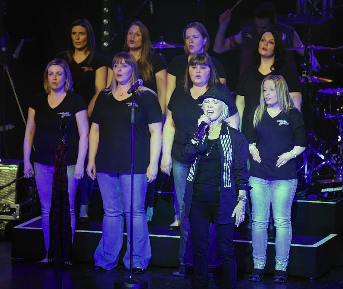 Lulu performs on stage with the Military Wives Choir earlier this year. The group have attracted another star performer